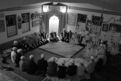 Members in a Nakshbandi tekke in Bosnia during a zikr ceremony, April 2009, black-and-white photograph, photographer: Nathalie Clayer; source: in private ownership.